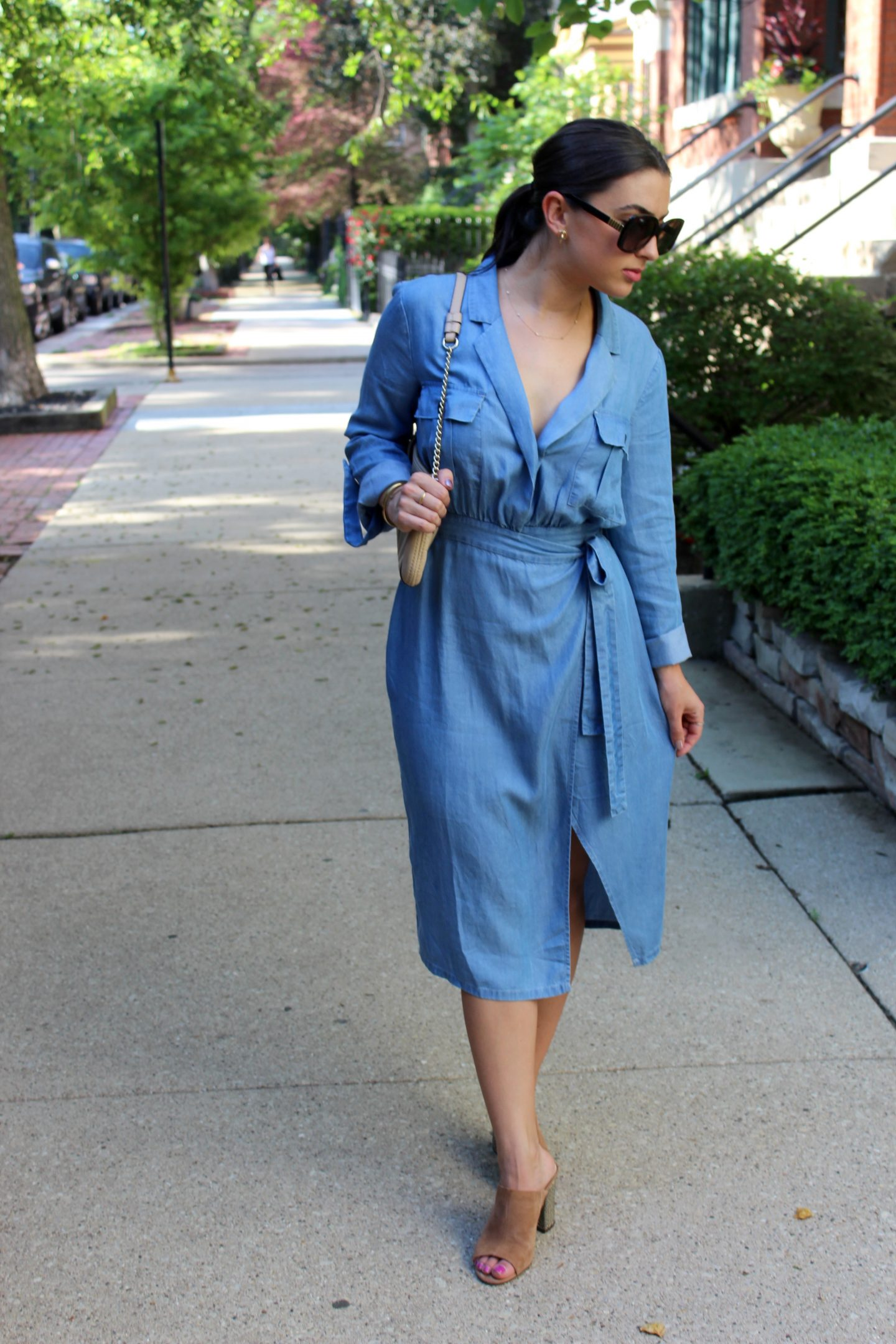 The Bellezza Corner wrap dress walking on the sidewalk