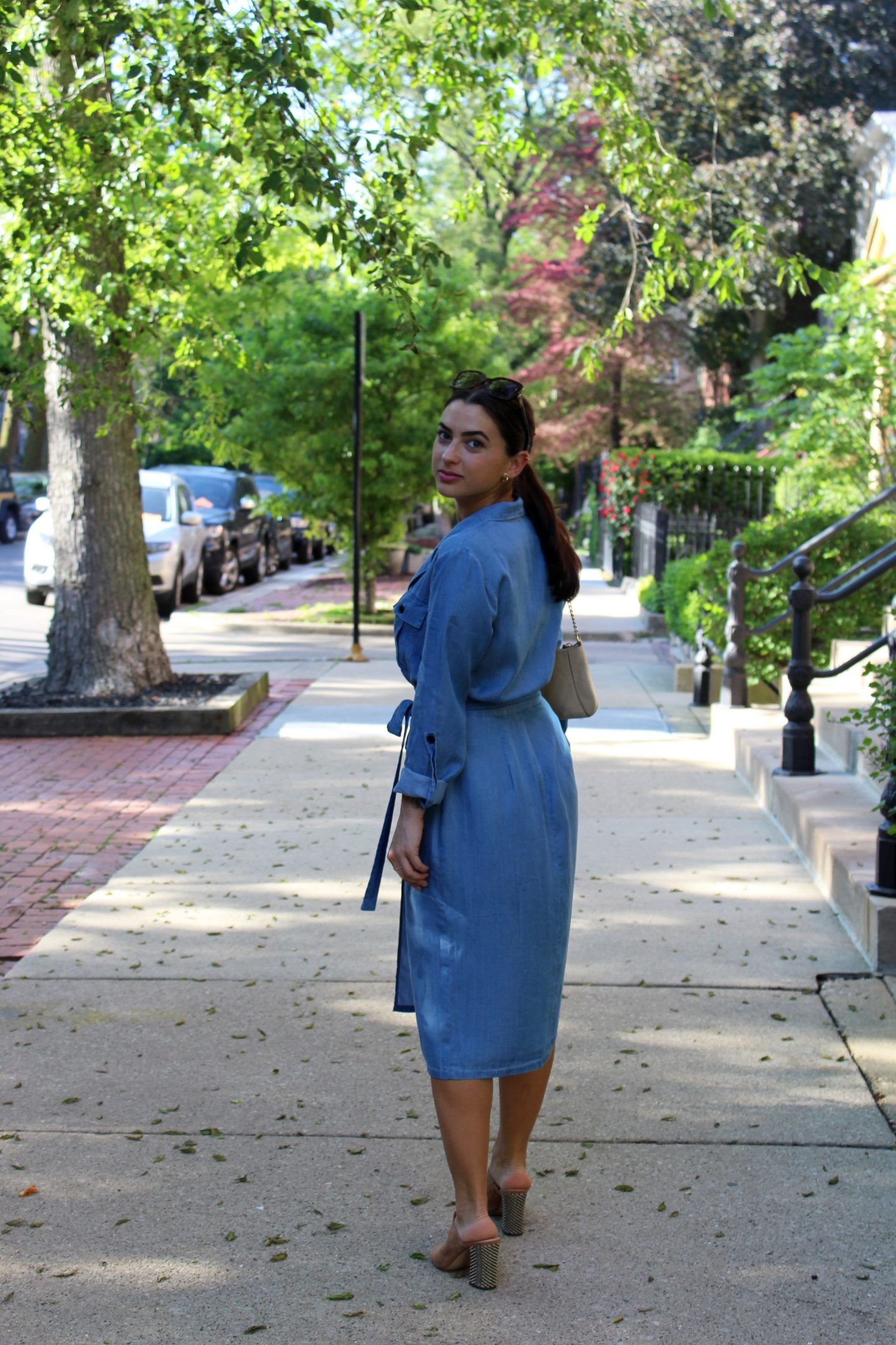 The Bellezza Corner wrap dress walking down the sidewalk